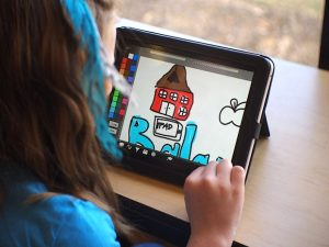 Child playing with ipad 300x225 Home Shopping with Kids